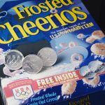 Olympic coins with Cheerio's box